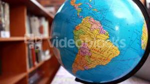 Focus on globe in the library