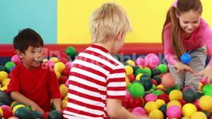 Cute children playing and having fun in the ball pool