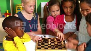 Preschool class learning how to play chess