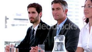 Business people sitting on interview panel