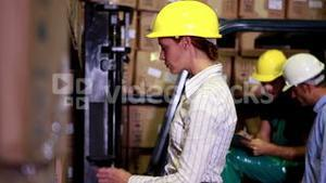 Warehouse manager scanning barcodes on boxes