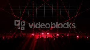 Nightclub with red laser show and dancing crowd