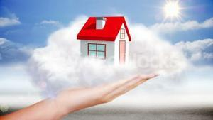 Hand presenting house graphic in cloud
