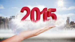 Hand presenting 2015 graphic in cloud