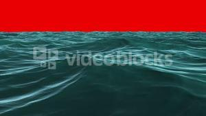 Choppy blue ocean under red screen sky