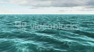 Choppy blue ocean under cloudy sky