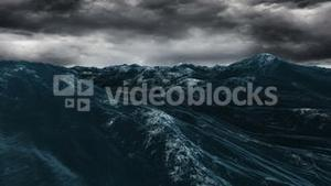 Stormy blue ocean under dark sky
