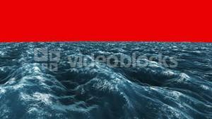 Stormy blue ocean under red screen sky