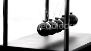 Newtons cradle in motion on white background