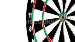 Green dart missing the bullseye on white background