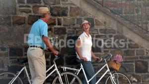 Senior couple going on a bike ride in the city