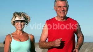 Senior couple jogging on a sunny day