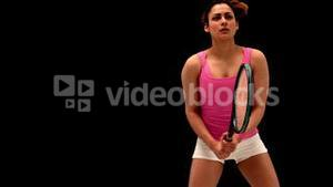 Fit young woman playing tennis