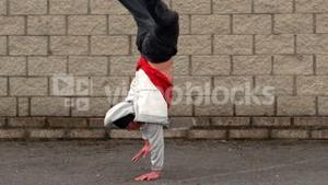 Cool young break dancer doing a handstand