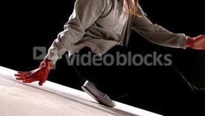 Cool young break dancer dancing on black background