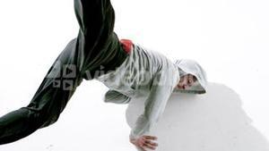 Cool young break dancer dancing on white background