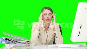 Businesswoman feeling stressed at her desk