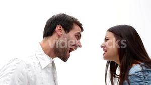 Angry young couple shouting at each other