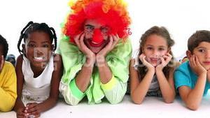 Cute children posing with funny clown