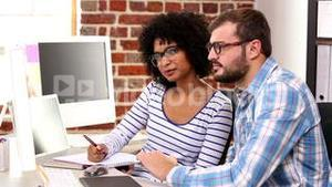 Casual business team working at desk with computer