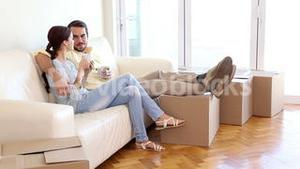 Attractive couple relaxing on couch