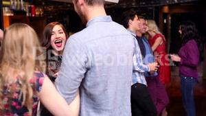 Attractive friends meeting up at the bar