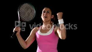 Tennis player celebrating a win