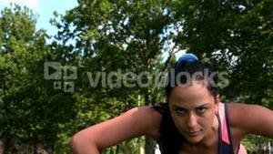 Fit brunette doing push up in the park
