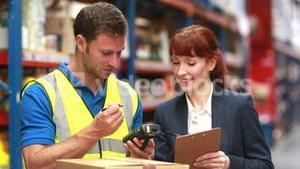 Warehouse manager and delivery driver smiling at camera