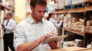 Warehouse manager using his tablet pc