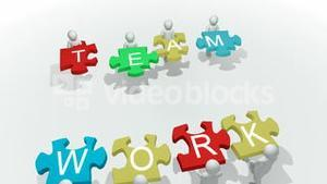 Computer animation showing 3d man with team work puzzle