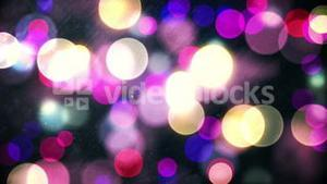 Glowing circles of light moving in purple hues