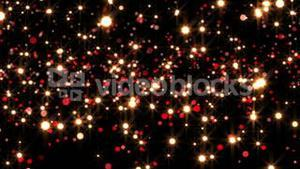 Red and gold glittering light on black