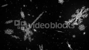 White snowflakes moving on black background
