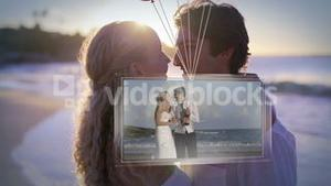 Balloons carrying screen showing newlywed couple on beach