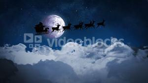 Santa and his sleigh flying over clouds loopable