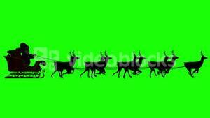 Santa and his sleigh flying against green screen background loopable