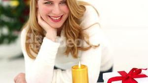 Festive blonde with christmas candle
