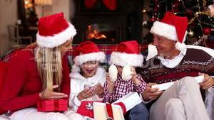 Happy family opening christmas gifts