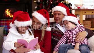 Happy family reading a christmas story together