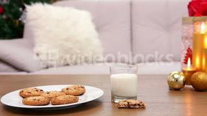 Coffee table with christmas gift bag and cookies