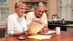 Older couple paying their bills