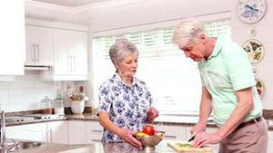 Senior happy couple making dinner together
