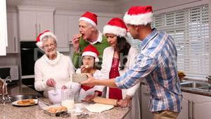 Three generation family baking together at christmas time