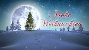 Frohe weihnachten message appearing in snowy landscape