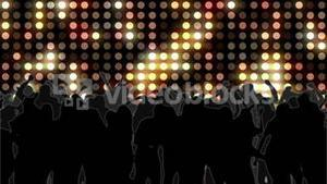 Nightclub with yellow mosaic wall of light and dancing crowd