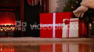 Santa delivering gifts under christmas tree