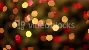 Blinking lights on christmas tree out of focus