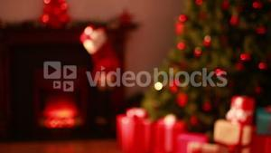 Blinking lights on christmas tree with presents