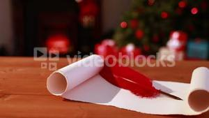 Scroll and quill on table at christmas